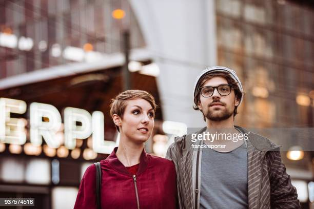 hipster couple in alexander platz - central berlin stock photos and pictures