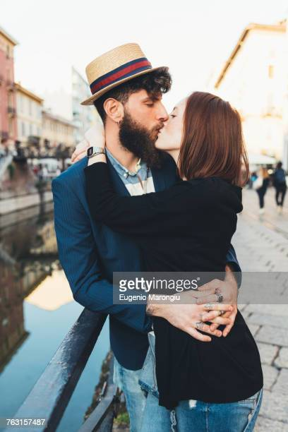hipster couple kissing by city canal - straw boater hat stock pictures, royalty-free photos & images