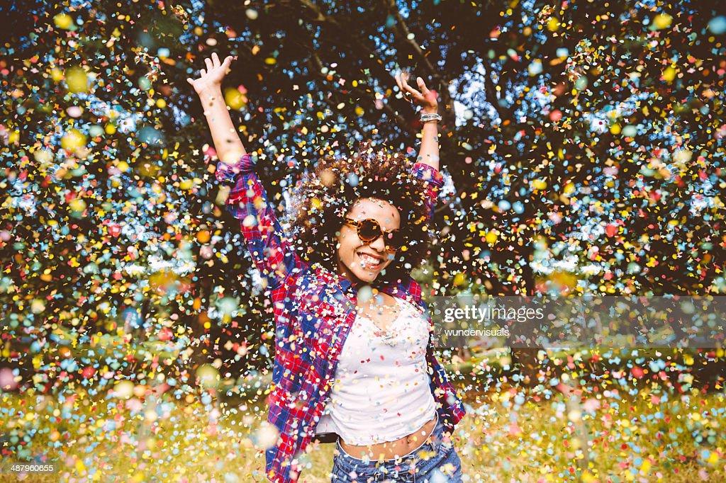 Hipster enjoying confetti : Stock Photo