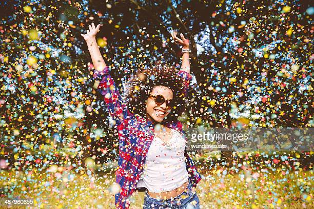 hipster enjoying confetti - joy stock pictures, royalty-free photos & images