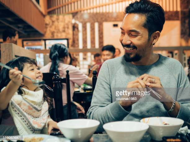 hipster father and his daughter enjoying in korea restaurant. - korean culture stock pictures, royalty-free photos & images