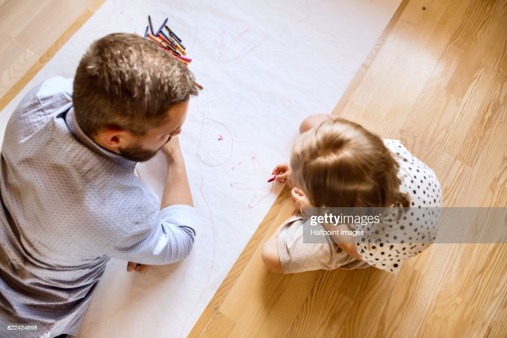 Hipster father and his little daughter drawing together. : Stock Photo