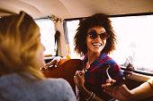Hipster friends in van