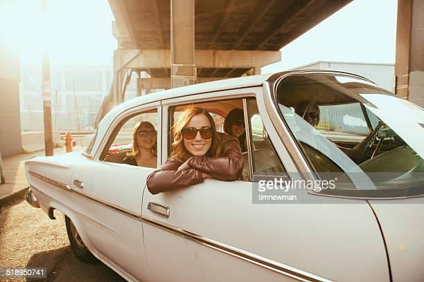 Hipster Friends In Vintage Car