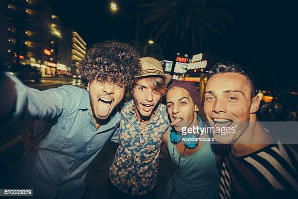 Hipster Friends Taking Selfie In Street At Night