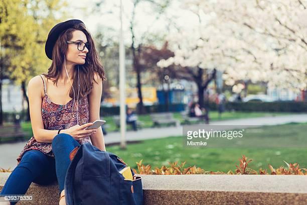 Hipster girl enjoying warm spring weather