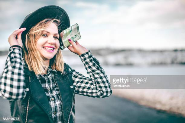 Hipster girl holding flask on the winter