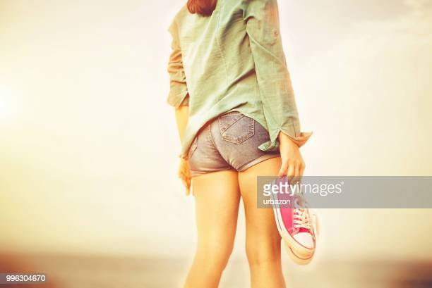 hipster girl on beach - gold shoe stock pictures, royalty-free photos & images