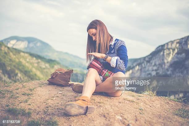 Hipster girl playing djembe