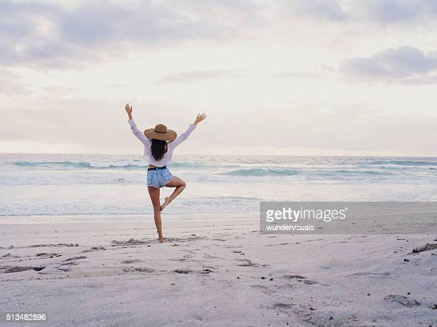 hipster girl practicing yoga pose on beach - zen like stock pictures, royalty-free photos & images