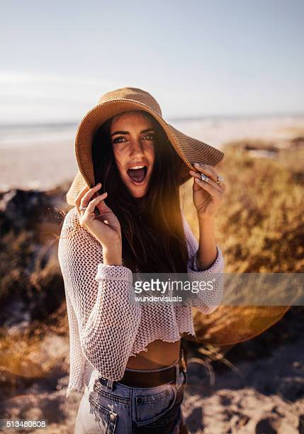 Hipster Girl  Smiling and Posing on Sandy Beach