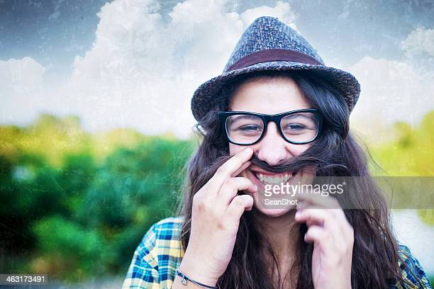 Hipster Girl Using Her Hair as a Mustache