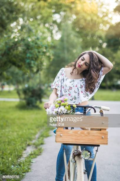 Hipster girl with cool stylish bike