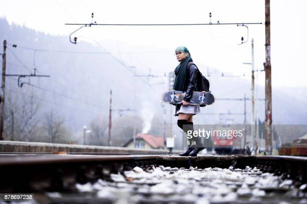hipster girl with skateboard - one teenage girl only stock pictures, royalty-free photos & images