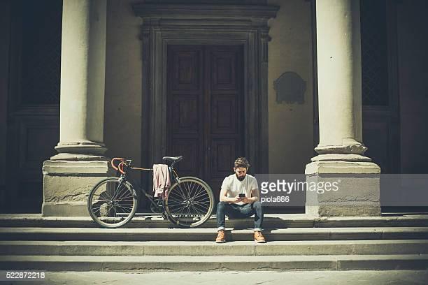 Hipster guy with bicycle in Florence