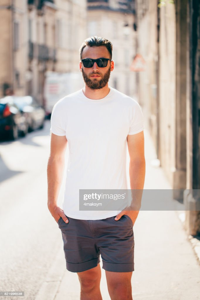 fbfea469d06e Hipster handsome male model with beard wearing white blank t-shirt with  space for your logo or design in casual urban style - stock photo