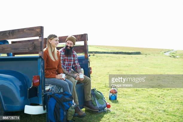 Hipster hiking couple on road trip, UK.
