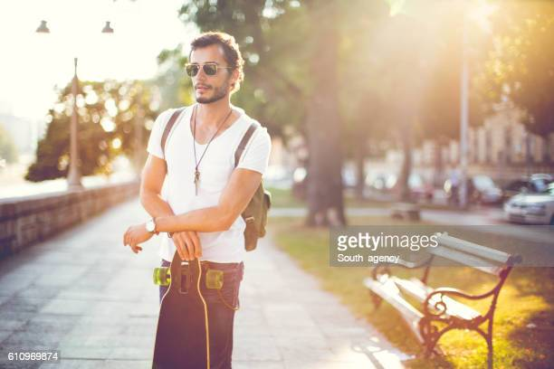 Hipster holding a longboard