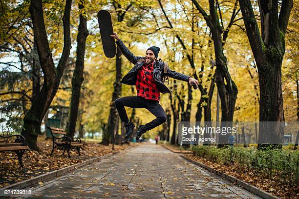 Hipster jumping out of happiness in the park