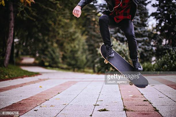 Hipster jumping with a skateboard