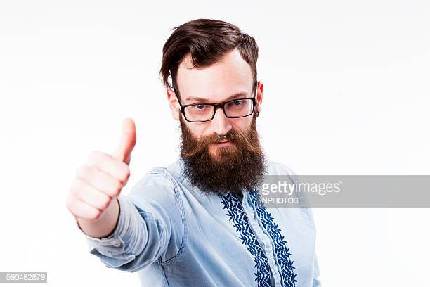 Hipster making OK gesture