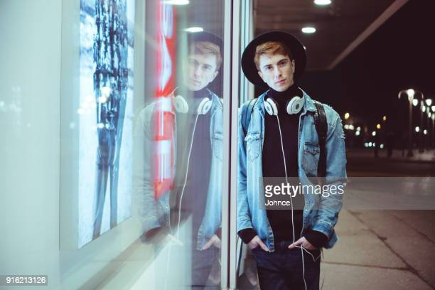 hipster man by the store window - all hip hop models stock photos and pictures