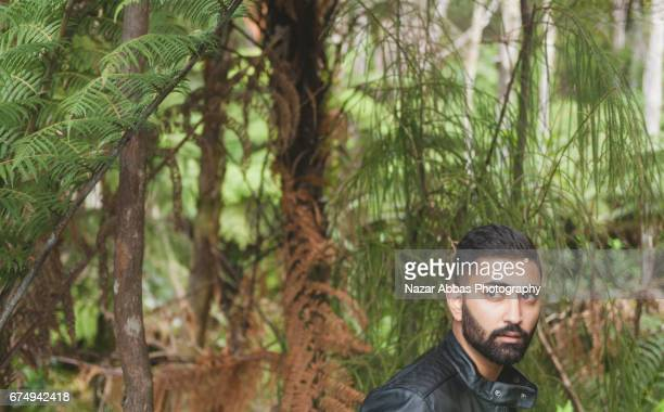 hipster man in an outdoor location. - handsome pakistani men - fotografias e filmes do acervo