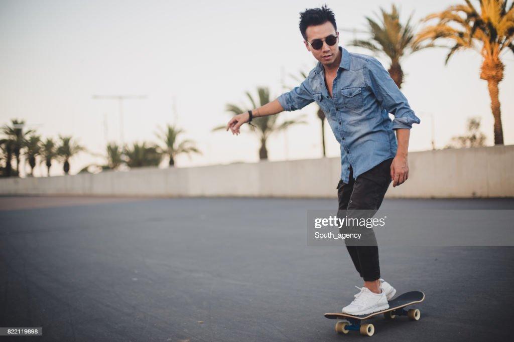 Hipster Man longboarding : Stock Photo