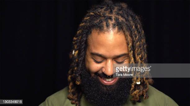 hipster man looking down - locs hairstyle stock pictures, royalty-free photos & images
