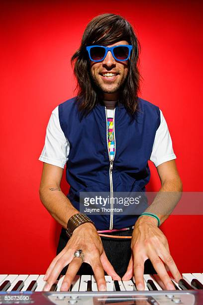 hipster man playing keyboard - keyboard player stock photos and pictures