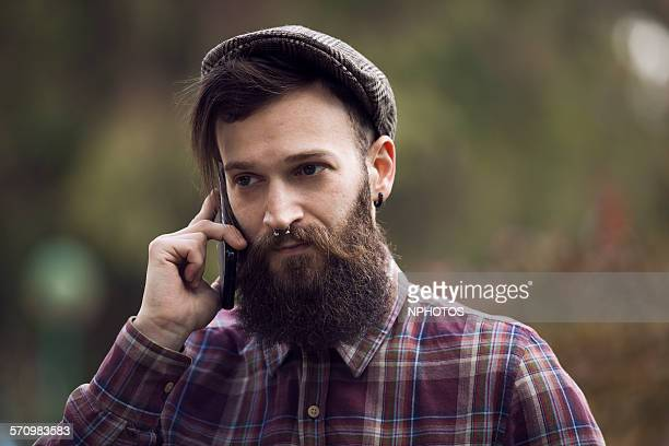 Hipster man talking at his cellphone