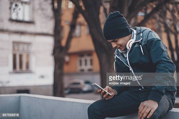 hipster man texting - send stock pictures, royalty-free photos & images