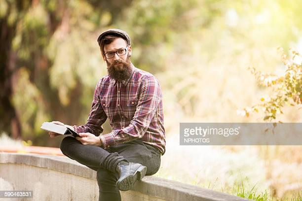 Hipster man using his digital tablet