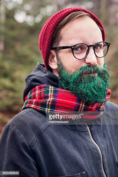 Hipster man with glitter beard ready for holiday season outdoors.