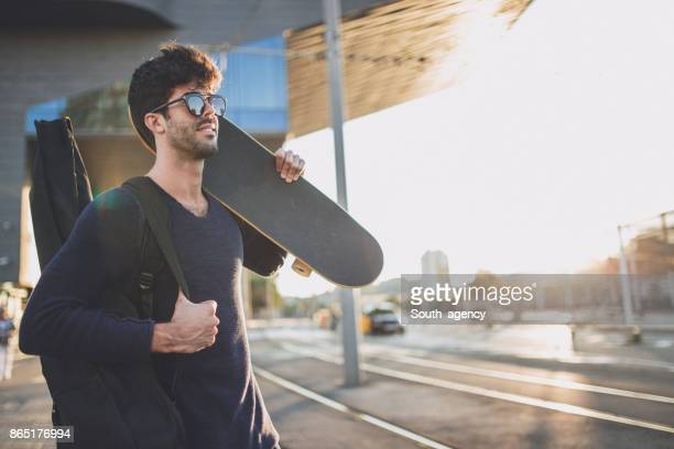 hipster man with guitar and skateboard - guitar case stock pictures, royalty-free photos & images
