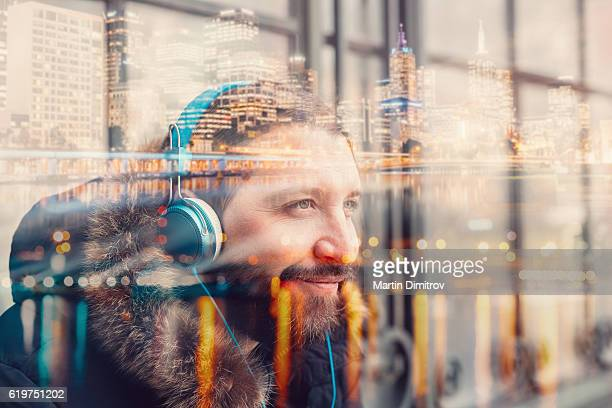 Hipster man with headphones in the city