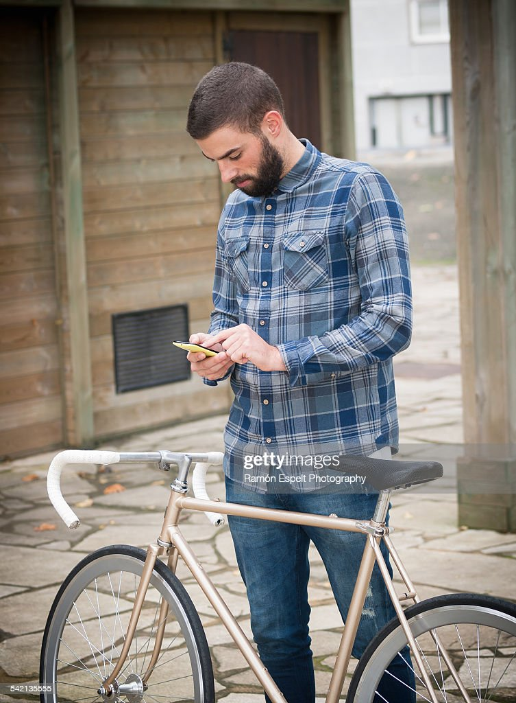 Hipster Man With His Fixie Bicycle Stock Photo Getty Images