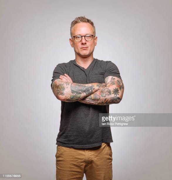 hipster man with short hair and tattoos - khaki trousers stock pictures, royalty-free photos & images