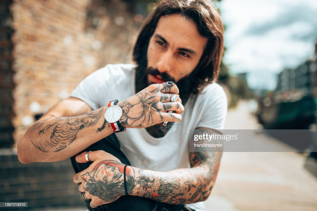 Hipster Man With Tattoo Smoking High-Res Stock Photo