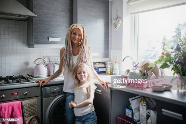 Hipster Mother with Young Daughter in their Kitchen