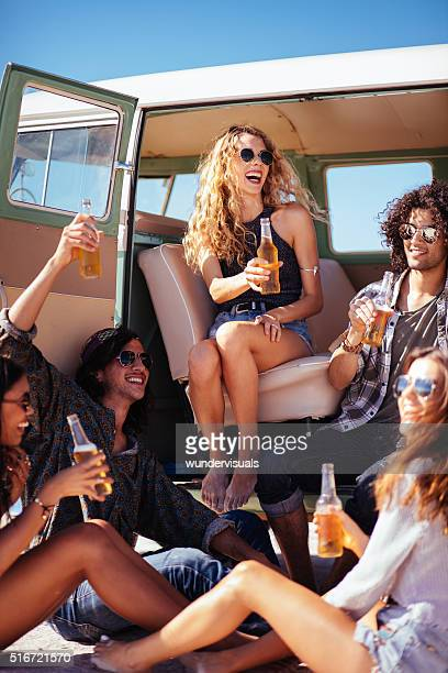 Hipster Multi-Ethnic Group Sitting in Back of Van Drinking Beer