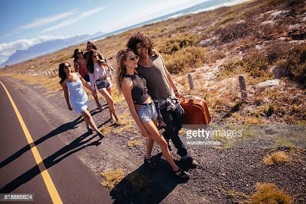 Hipster Multi-Ethnic Group Walk Down Highway Shoulder Together