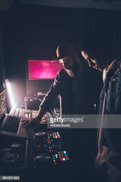 Hipster music producer and singer working together in recording studio