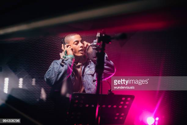 hipster musician singing and recording songs in professional music studio - pop musician stock pictures, royalty-free photos & images