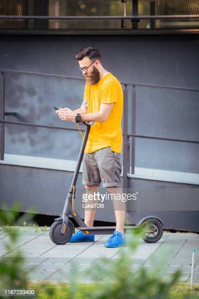 young bearded man yellow tshirt typing