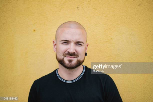 hipster on yellow background - completely bald stock pictures, royalty-free photos & images
