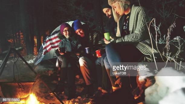 Hipster people camping in forest