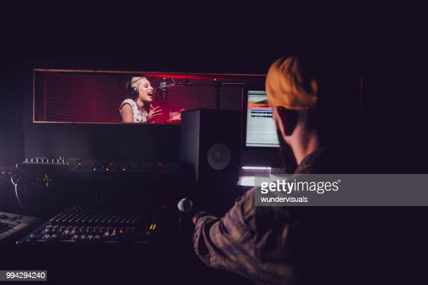 hipster pop music artist recording song at professional music studio - recording studio stock pictures, royalty-free photos & images