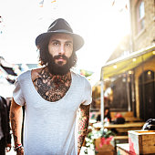 Hipster portrait with body full of tattoo