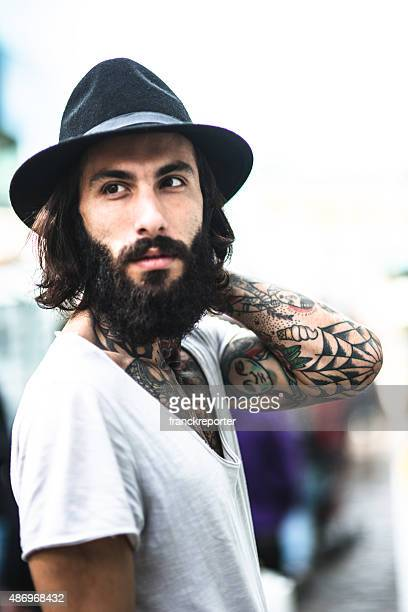 Hipster portrait with tattoo